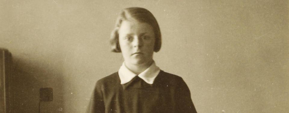 Bilden visar en flicka.